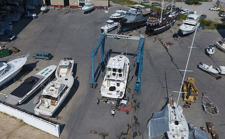 boat yard with yacht being worked on