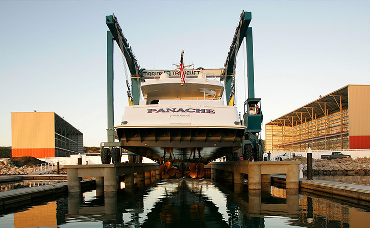 yacht being lifted over water
